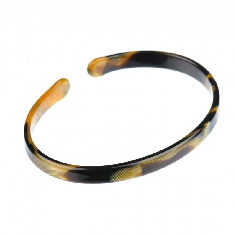 Medium size oval shape Bracelet in Black and gold texture shiny finish